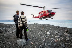 an-air-greenland-bell-212-helicopter-approaching-a-landing-site-near-the-ilulissat-ice-fjord-in-greenland